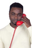 Attractive african man with a red phone Royalty Free Stock Image