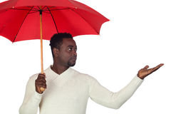 Attractive african man with a red umbrella Stock Photography