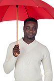 Attractive african man with a red umbrella Royalty Free Stock Photos