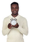 Attractive african man with a silver clock Royalty Free Stock Photos