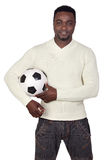 Attractive african man with a soccer ball Royalty Free Stock Photo