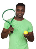 Attractive african man with a tennis racket Royalty Free Stock Image