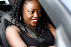Attractive African woman driving her car Royalty Free Stock Photography