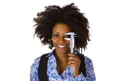 Attractive african woman holding caliper Stock Images
