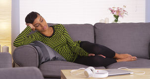 Attractive African woman sleeping on couch Stock Image