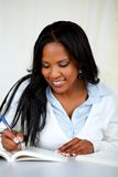 Attractive african woman studying Stock Photos