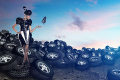Attractive african woman on tires on the blue sky Stock Images
