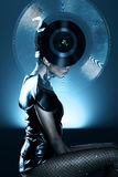 Attractive african woman with vinyl record on head Royalty Free Stock Image