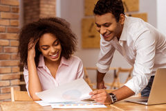 Attractive Afro-American couple working Stock Images