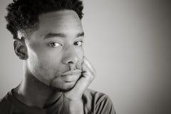 Attractive afro-american man posing in a  studio Stock Photos