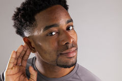 Attractive afro-american man posing in studio Stock Photography