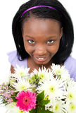 Attractive Afro-american woman holding flowers Stock Photography