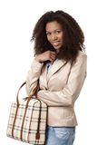 Attractive afro woman with handbag smiling Royalty Free Stock Photos