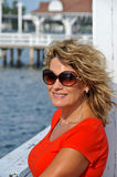 Attractive Middle Age Woman in Sunglasses Wearing  Royalty Free Stock Photography