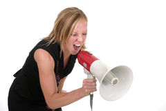 Attractive Aggressive Blonde Business Woman 1. Attractive young executive business woman making her point really clear with the aid of a megaphone royalty free stock photography