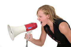 Attractive Aggressive Blonde Business Woman 2. Attractive young executive business woman making her point really clear with the aid of a megaphone Royalty Free Stock Photos
