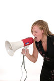 Attractive Aggressive Blonde Business Woman 3. Attractive young executive business woman making her point really clear with the aid of a megaphone royalty free stock images