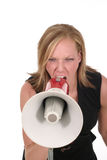 Attractive Aggressive Blonde Business Woman 6. Attractive young executive business woman making her point really clear with the aid of a megaphone royalty free stock photo