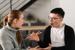 Attractive angry couple fighting and shouting at each other royalty free stock photography