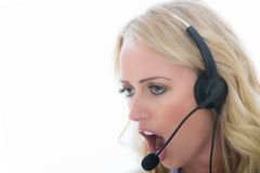 Attractive Angry Young Business Woman Using a Telephone Headset Royalty Free Stock Photography