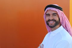 Attractive Arabic man smiling with copy space