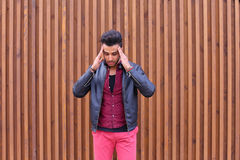 Attractive Arabic Young Man, Student Feels Headache, With Head a. Handsome Young Arabic Male Man, Student Feels Headache, Touching Head, Trying to Ease Pain Royalty Free Stock Photo