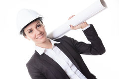 Attractive architect holding blueprints and. An Attractive architect holding blueprints and wearing helmet. All on white background Royalty Free Stock Image