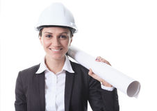 Attractive architect holding blueprints and. An Attractive architect holding blueprints and wearing helmet. All on white background Stock Images