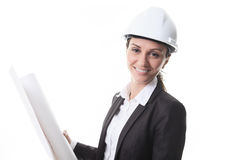 Attractive architect holding blueprints and. An Attractive architect holding blueprints and wearing helmet. All on white background Stock Image