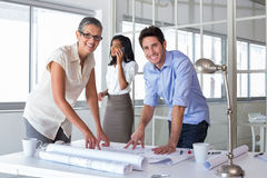 Attractive architects going over plans Royalty Free Stock Photo