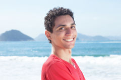 Attractive argentinian guy at beach Stock Photo