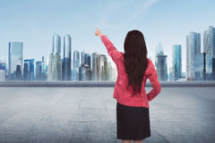 Attractive Asian business woman pointing something empty space Stock Photography