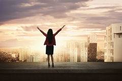 Attractive asian business woman standing on an edge a rooftop Stock Photo