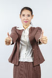 Attractive Asian business woman with thumb up Stock Photos
