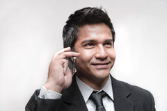 Attractive Asian Businessman answering his phone Stock Photos