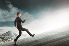 Attractive asian businessman running to uphill mount Stock Photography