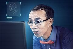 Free Attractive Asian Businessman Using Face Recognition Royalty Free Stock Photo - 142931725