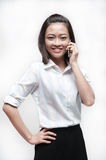 Attractive asian businesswoman holding a handphone Stock Photos