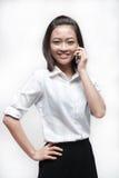 Attractive asian businesswoman holding a handphone Stock Photos