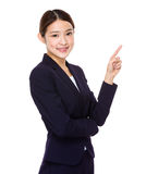 Attractive asian businesswoman showing on white background Royalty Free Stock Images