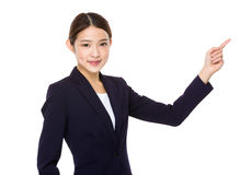 Attractive asian businesswoman showing on white background Royalty Free Stock Photos