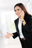 Attractive asian businesswoman talking by cellphone Stock Photography
