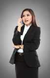 Attractive asian businesswoman talking by mobile phone Stock Photos
