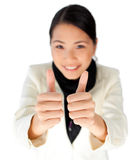 Attractive asian businesswoman with thumbs up Royalty Free Stock Image