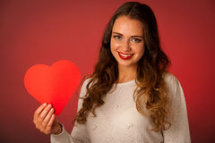Attractive asian caucasian woman holding red heart in her hands Royalty Free Stock Image