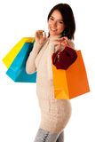 Attractive asian caucasian woman with shopping bags Stock Photography