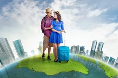 Attractive asian couple with backpack and suitcase traveling aro Royalty Free Stock Images