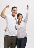 Attractive Asian Couple Cheering Royalty Free Stock Photos
