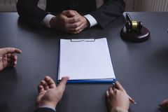 Attractive asian couple consulting a lawyer about contract agreement,blank white documents for graphic montage. stock images