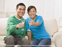 Attractive Asian Couple Toasting Stock Images